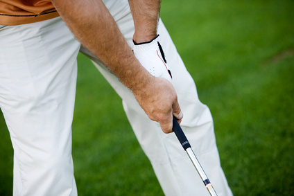 Golfer waiting for his turn, focus on hand