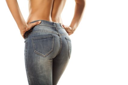 view from behind on the pretty female ass in jeans on white